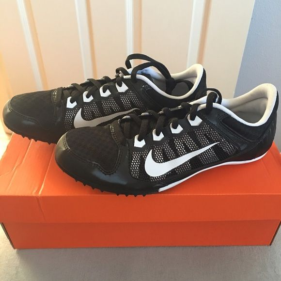 Nike Track Shoes Black and white Nike track shoes. These are sprinting/mid distance race shoes. Includes never used spikes, screw (to apply and take spikes off), and plastic Nike track and field bag. Never worn. Nike Shoes Athletic Shoes