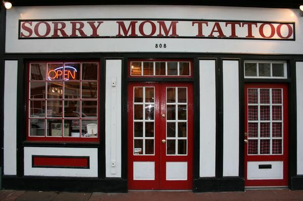 Sorry Mom Tattoo is located in the heart of Downtown Fredericksburg, on Caroline St.    Owned/Operated by Wes Moore and managed by Gary Clark.    With a really catchy name and good reviews, Sorry Mom Tattoo seams to be producing awesome work since march 2007 when they opened their doors. They specialize in American traditional, Japanese traditional, Latino traditional, black and grey portraits, color portraits and custom tattoos and lettering.