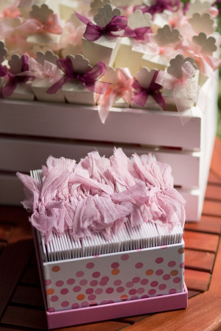 Order of service cards and confetti cone display with pink silk ribbon {Image credit Martin Dabek Photography}
