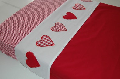 Appliqué shapes, maybe a name or phrase to top sheet. Easy way to personalize!