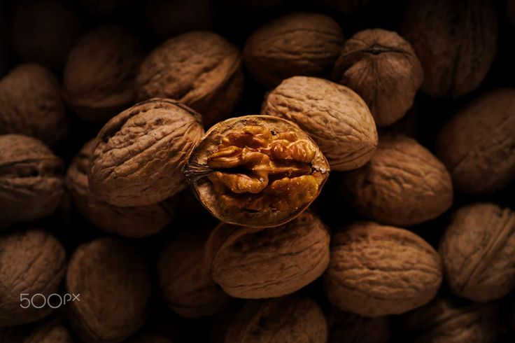 Walnut kernel in half opened shell in middle of other walnuts by Luka M on 500px