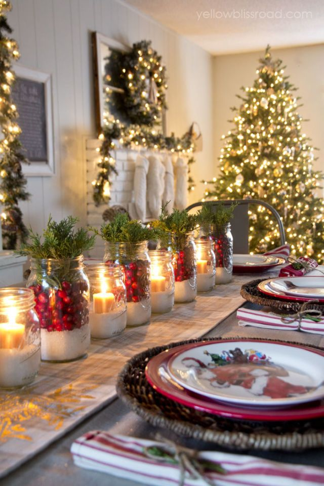 "Kristin, the blogger behind Yellow Bliss Road, opted for a look that's equal parts ""glam, rustic, and classic."" Jars filled with epsom salt, cranberries, and freshly cut juniper serve as the centerpiece, while plenty of white lights set the mood. - WomansDay.com"