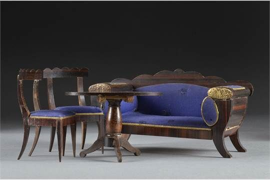 A German drawing room setting, comprising sofa with dark graining, blue upholstery, gilt embossed
