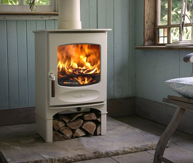 Charnwood's C-Series (C-Four), classically styled wood burning stove. I like the natural slab underneath.
