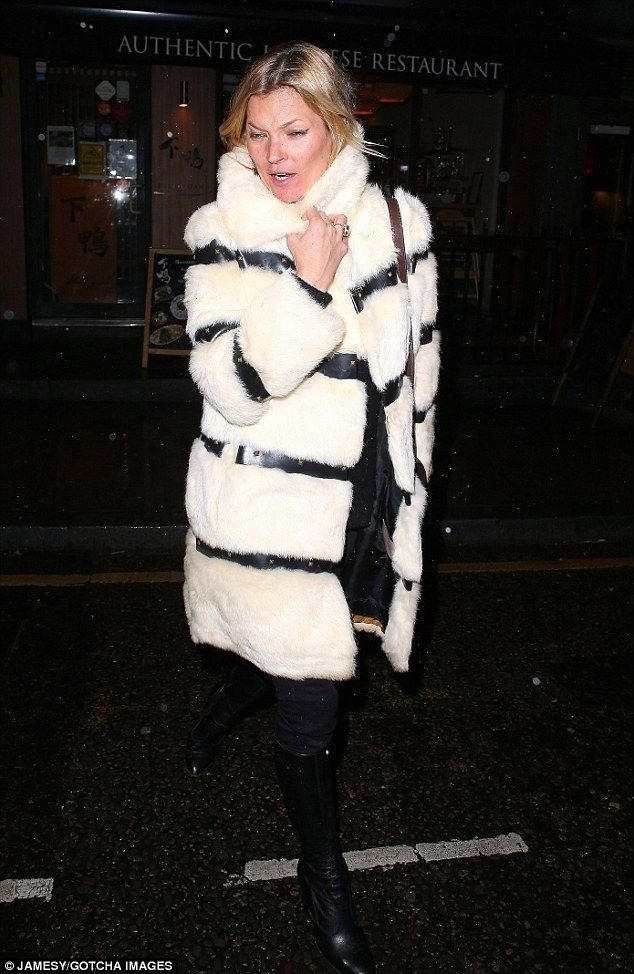 Wild Is The Wind!Kate Moss was unimpressed with weather on Wednesday night as she stepped out in London