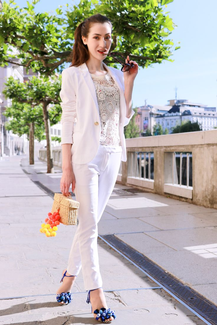 Fashion blogger Veronika Lipar of Brunette From Wall Street sharing how to style feminine white pant suit and sandals for party this summer