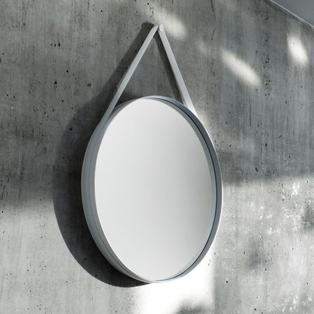 Strap is a playful round #mirror by HAY with a frame in powder coated steel and a silicone strap to hang it on the wall. The silicone strap comes in grey and optional in mint, rose or yellow.
