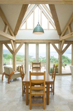 A very grand space for eating, in this open plan house with views of the lake. By Roderick James Architects.