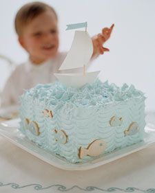 I remember making this sailboat cake for my son's 1st birthday. So cute with its little paper boat and fluffy blue frosting.  via marthastewart.com