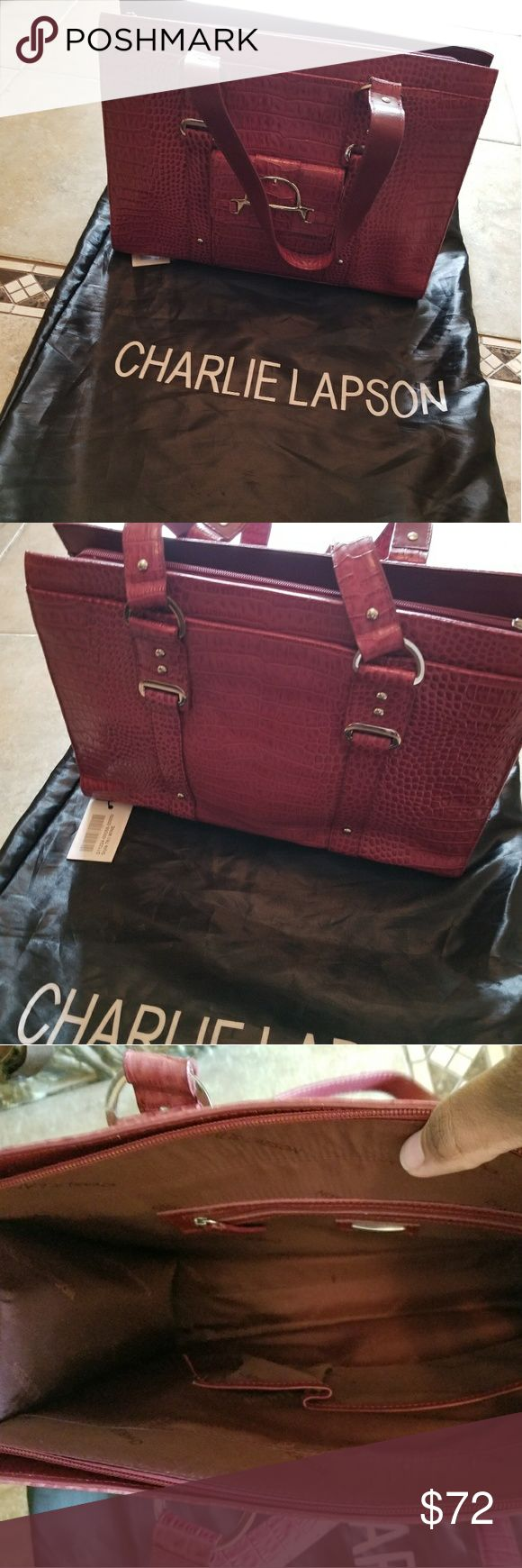 Charlie Lapson Tote Large Wine crocodile embossed leather features double strap with 2 large outside pockets along with 1 small front outside pocket. Purse features a zipper compartment on inside. No stains, pen or pencil marks on inside, but small area where the color has peeled.  Straps not worn. Gently worn once. Purse a little dented from storage only. Comes with original storage bag. Charlie Lapson is known for making exclusive leather handbags for the stars! An original purchase from…