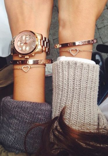 Try stacking your watches with gold bangles to give your look that extra chic edge! Loving these Cartier bracelets