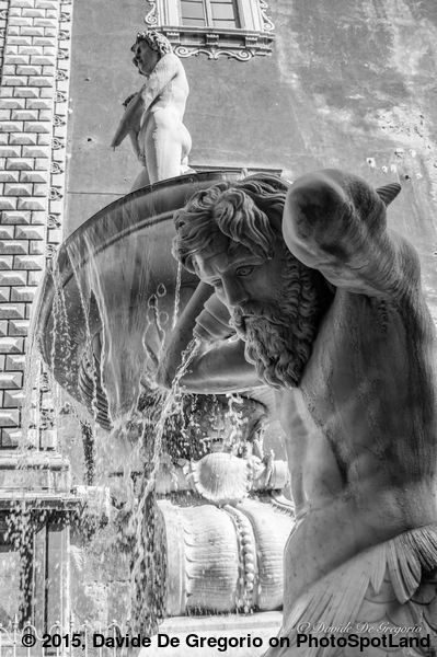 """The Amenano Fountain, #Catania #Sicily.The Amenano fountain (in Sicilian dialect called """"Acqua 'o linzolu"""") is located on Piazza Duomo in Catania and was built in 1867. The falling water from the tank produces a waterfall effect that gives the feel of a bed sheet and flows into the river below at a level of about two meters under the square. Photospot bu Davide De Gregorio on http://www.photospotland.com/spots/566 #photography #blackandwhite #travel"""