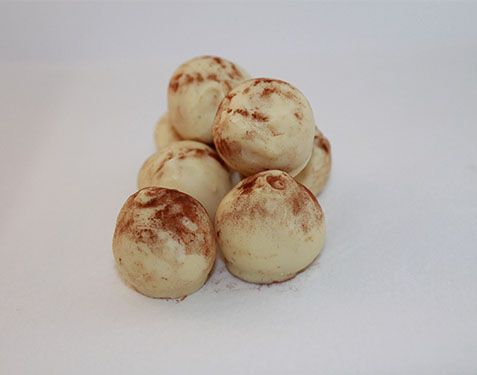 Syrup Sponge Truffle  Sweet syrupy balls of truffle coated in smooth white chocolate and dusted with cocoa. Pre packed in 100g cellophane bags.