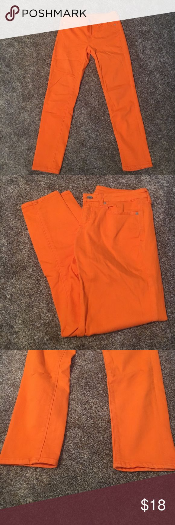 Bright Orange Skinny Jeans Bright orange skinny ankle jeans from JCPenneys are in excellent condition. High stretch denim. Size 29 (8). 54% cotton, 27% polyester, 18% rayon, 1% spandex. jcpenney Jeans