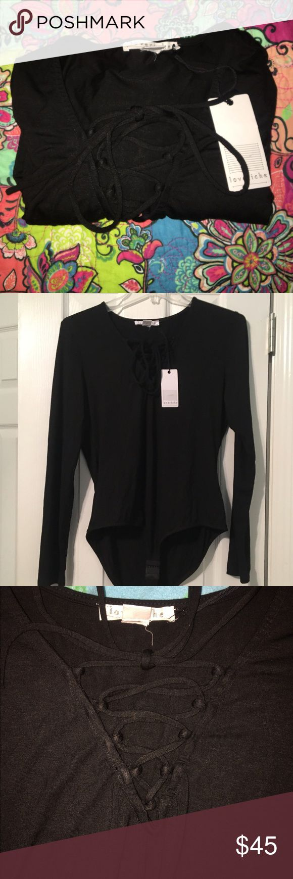 NWT BOUTIQUE WOMEN'S BODYSUIT NEW WITH TAGS!!  Women's bodysuit size large can fit medium.  Ties up in the front as you can see in the picture.  Bought from a very nice {and expensive} boutique.  Paid a lot$$$ Love Riche Tops