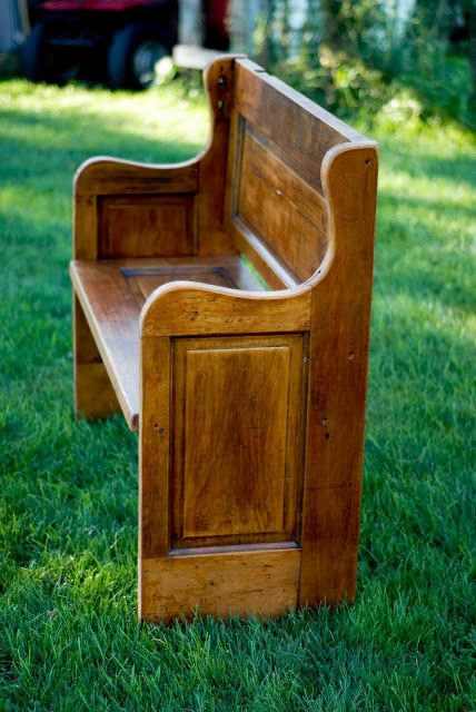 Bench made from reclaimed doors. Looks like an old church pew. Would be great inside an entranceway, place to take off your shoes and check the mail.