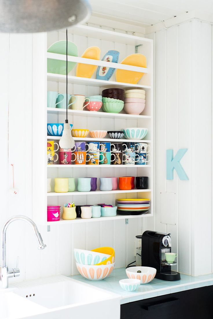 Organize your kitchen cups and bowls.  They will look like a artful masterpiece is they are bright colored like these.