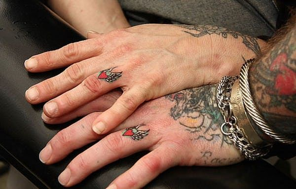 30 Creative And Romantic Wedding Tattoos Ring Tattoo Designs Finger Tattoos Wedding Band Tattoo