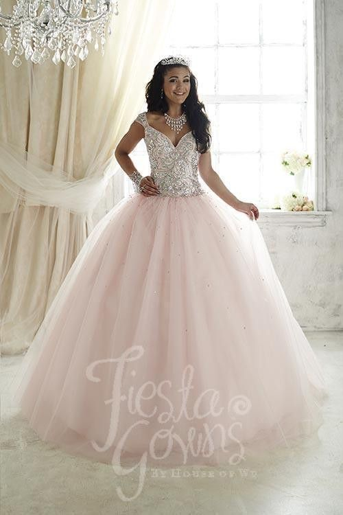 Glittering tulle flecked with tiny sequins bring together this fiesta gown, studded with chunky AB stones and beaded straps. Download the Fiesta Gowns by House of Wu sizing chart here. *Note lead time