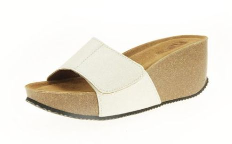 Zaffiro Bianco: A soft and smart white glitter sandal on a high wedge with cushioned anatomic footbed.