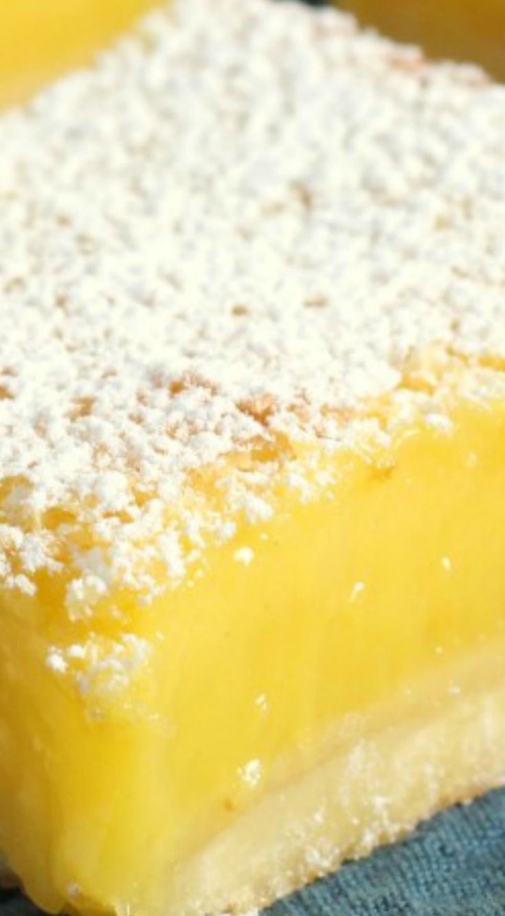 Perfect Lemon Bars ~ Smooth, tangy lemon filling baked on a shortbread crust and dusted with powdered sugar.