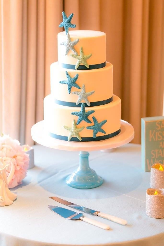 Beach inspired wedding cake with ombre blue sugar starfish...FUN! By Sweet Cheeks. At Paradise Point Resort with The Best Wedding For You Coordinating.