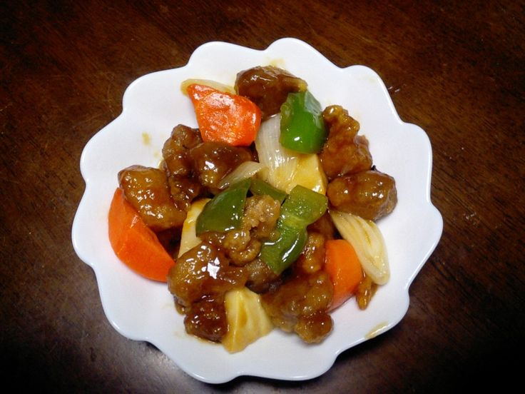 Every Chinese restaurant in America has their own recipe for sweet and sour pork. Most of them contain pork, pineapple, bell pepper, water chestnuts, bamboo shoots and scallions. The difference between them lies in the sauce. In America,ketchup is normally used, but in traditional Chinese cooking they use shan jah beng (compressed plum wafers).
