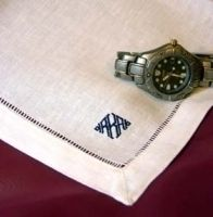 Linen mans handkerchief embroidered with a classic monogram.
