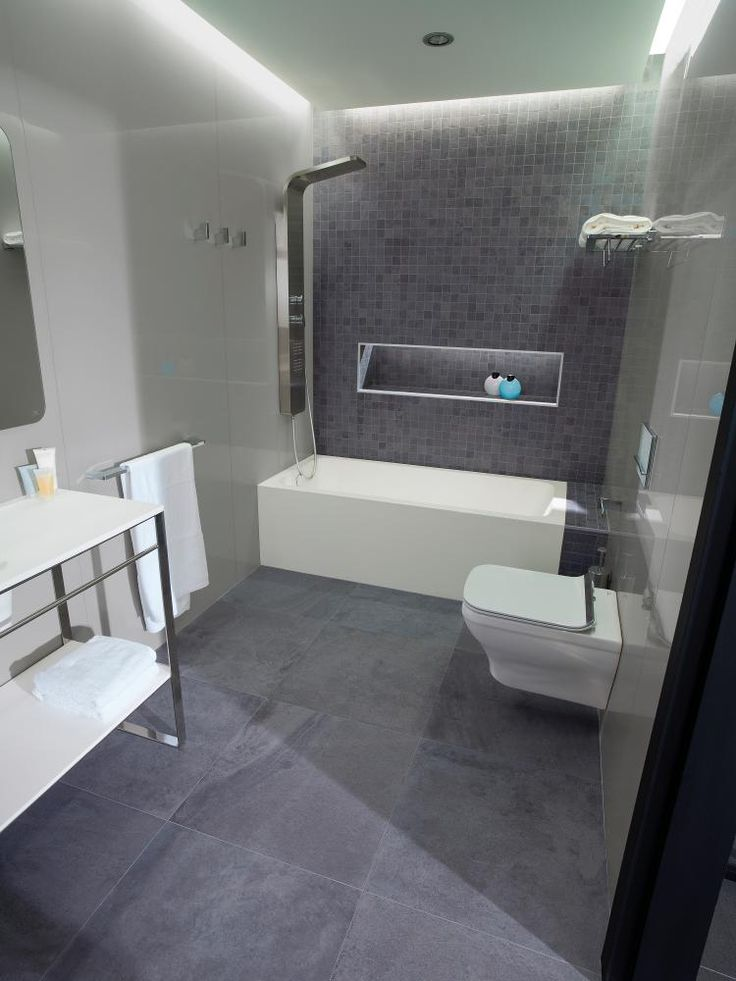 Deep Grey - floor tile shown. Blue toned stone, looks quite slate like. Would look quite striking with a dark grout. £24.99 per sqm Mosaic on the wall is £49.99 per sqm