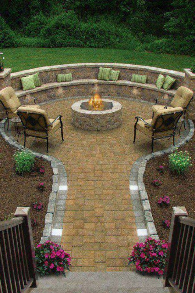 Awesome fireplace patio idea. Great way to make the backyard functional for guests without having to walk through the grass :)