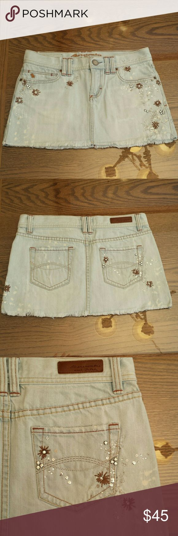 *Lowest* A&F mini skirt Size 0 light washed, bleach splatter look. Has sequin and rhinestone detail, super cute and very lightly worn. Hand wash and hang to dry. No trades. Abercrombie & Fitch Skirts Mini