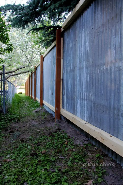 Corrugated metal fence out of reclaimed materials