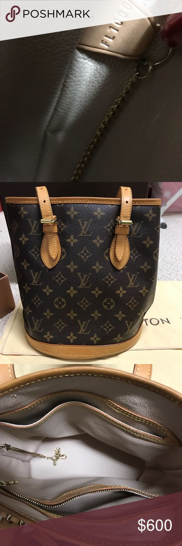 LOUIS VUITTON BUCKET BAG This is an authentic louis vuitton bucket bag that was purchased a while back. This bag is in great condition and one of the best you'll find on the market for this price.   This purchase comes with dust bag and the box.  Please feel free to leave any questions or offers Louis Vuitton Bags Shoulder Bags