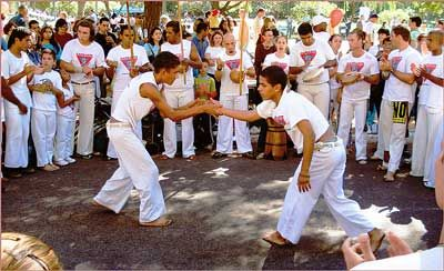 Capoeira - Brazil: (pronounced Capo-wa-ra) is a Brazilian art form and self-defense; with strong aerobic and dance elements. It is a mixture of body and soul, fighting and dancing, of music instruments and voice requiring the use of mental physical and emotional agility. The emphasis is not on how well you sing or perform but on how much energy you commit to trying. It is a harmony of forces that gives you power, flexibility, endurance and self-discovery.
