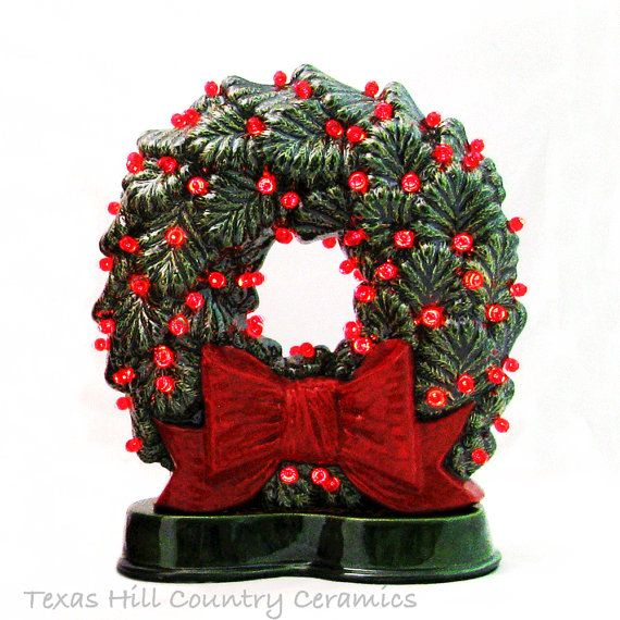 If you love old fashioned ceramic Christmas Wreaths sitting in a window showing off its lights then this wreath with a big red bow is for you. The double sided Sierra Spruce wreath sits on a slim base making it ideal for narrow shelves, window sills, fireplace mantels or confined areas.