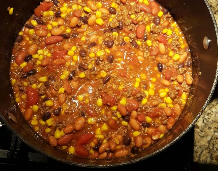 Taco Soup 2 lbs cooked ground beef;  1- 15oz can kidney beans, drained;  1- 15oz can pinto beans,  drained; 1- 15oz can black beans, drained; 1- 15oz can diced tomatoes; 3- 8oz cans tomato sauce; 1.5- 16oz bag frozen corn; 2 pkg Mccormick's taco seasoning; 1 cup water. Mix all ingredients in large pot, heat till hot. Serve with cheese, crackers or fritos, and sour cream.