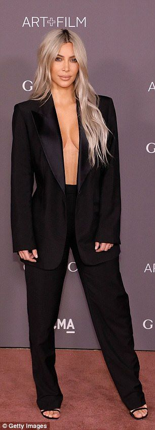 Style queen: Kim, who posed up a storm in towering strappy black heels, ensured to stick to an all-black colour scheme