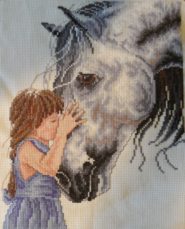 Finished Cross Stitch - Little Girl kissing her horse.
