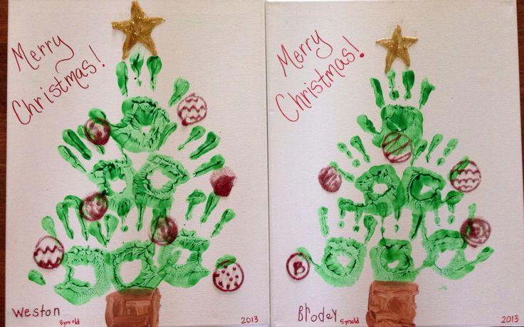 Hand print Christmas tree on canvas board