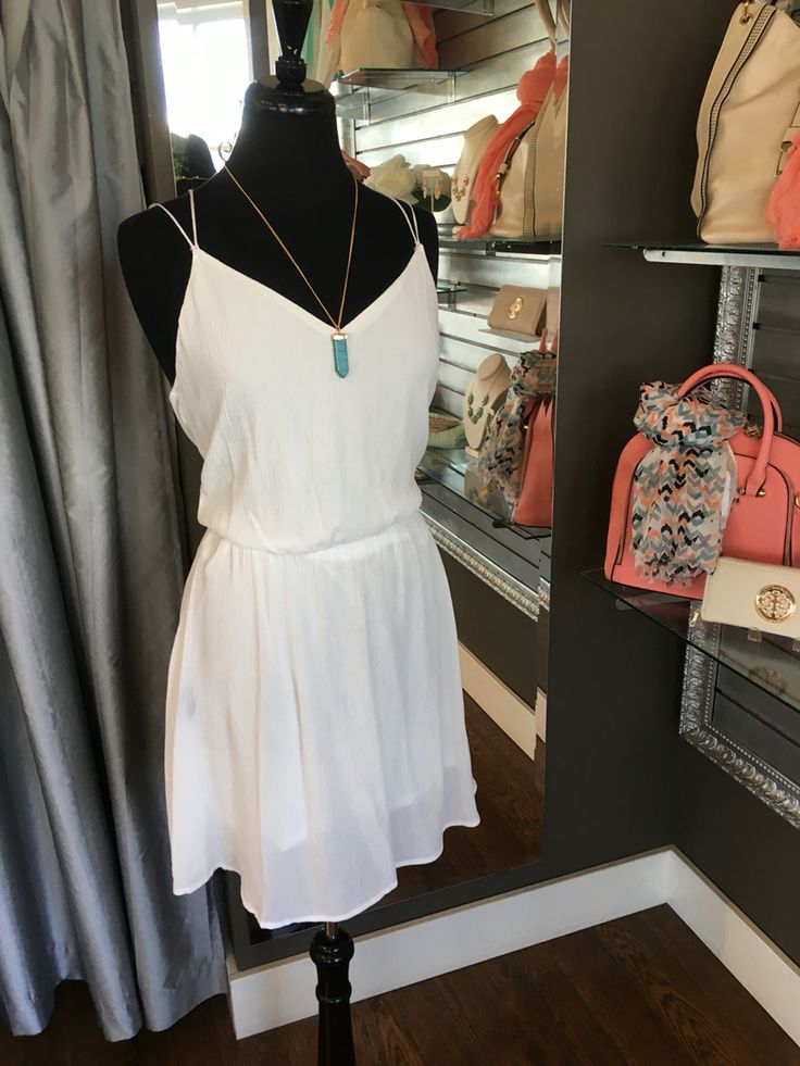 Dainty White Summer Dress - This will be a winner this season! The dainty straps and a racerback style with lace inlay makes this dress very feminine and perfect for warm summer weather. (Dainty White Summer Dress $58CAD) #summer #summerstyle #fashionista