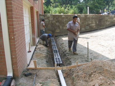 Buidling a driveway drain drainage pinterest driveways for Residential trench drain systems