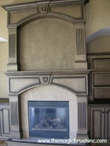 One of my favorite fireplace finishes and I had this in my home for several years.  It's a bronze metallic paint with a dark chocolate metallic glaze. YUMMMMY.