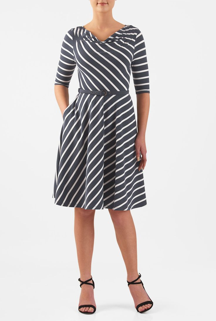 A draped cowl circles the neck of our stretchy jersey knit dress styled with pleated shoulders and a bias-cut flared skirt for a flirty twirl.