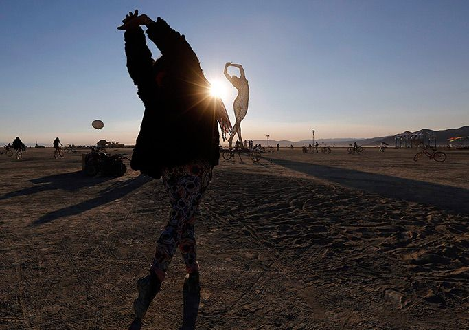 Credit: Jim Bourg/Reuters Rochelle Schieck, Founder of Qoya, dances by the Truth is Beauty sculpture created by Marco Cochrane
