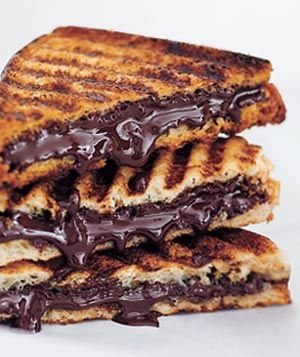 Ingredients: 4 slices challah or white bread, 2 ounces semisweet chocolate, chopped Directions:  Form 2 sandwiches with the bread and chocolate. Transfer to a hot panini press or waffle iron and cook until the bread is golden and the chocolate has melted, 2 to 3 minutes. (Alternatively, cook the sandwiches in a hot grill pan, turning once and pressing down frequently.)