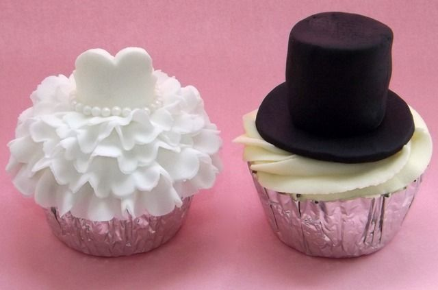bride and groom cupcakes. I'd get chocolate and vanilla frosting...groom's red velvet :)