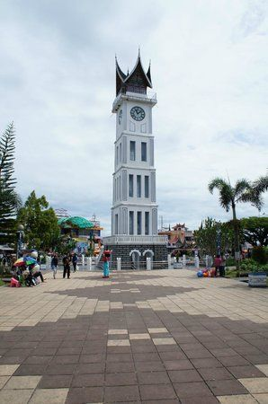 """Jam Gadang ( Minangkabau for """" Big Clock"""" ) is a clock tower and major landmark and tourist attraction in the city of Bukittinggi, West Sumatra, Indonesia. It is located in the centre of the city, near the main market, Pasar Ateh. It has large clocks on each face."""