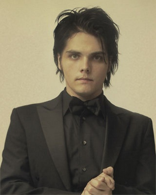 Finally! Something for the groom I love this suit and bow tie combo, knew I would have to look in my fav bands style :P