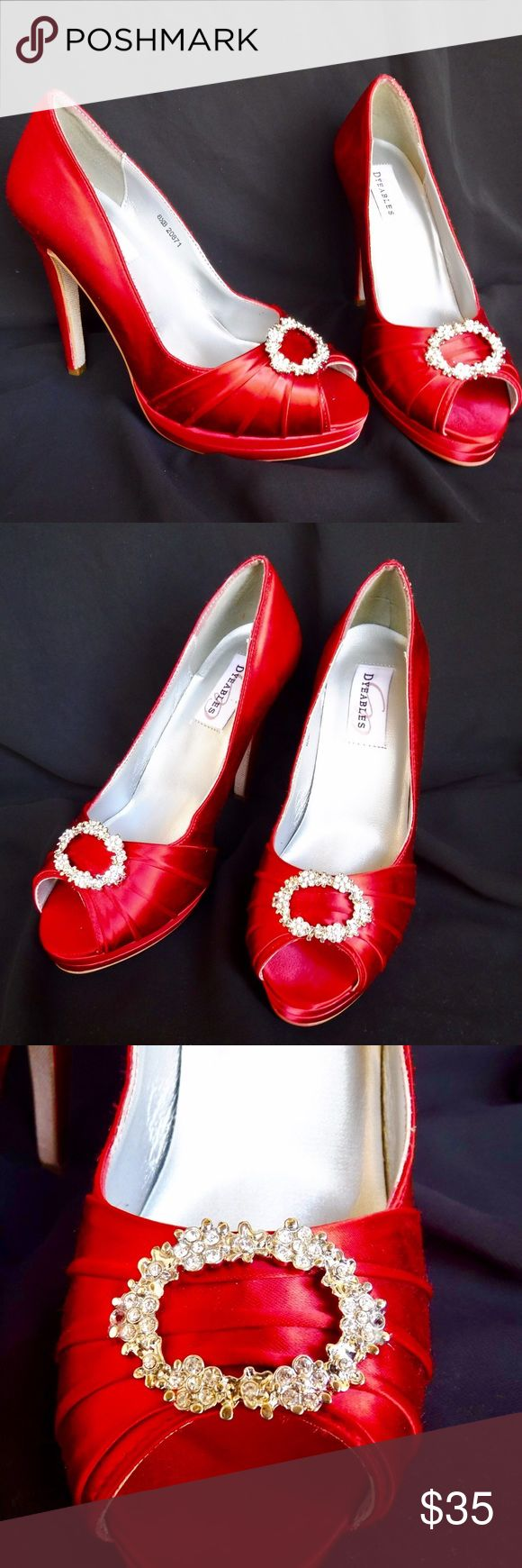 """Ruby Red Platform Peep-Toe Pumps NWOT Dyeables Ruby Red Satin Platform Pumps in style Gianna. These have never been worn and are in perfect condition. I just don't have the box any longer. Shoe has a sparkly jewel encrusted accent piece to make any special occasion outfit really shine! Size 8.5, man made materials with a leather sole. Heel height is 4"""". Dyeables Shoes"""