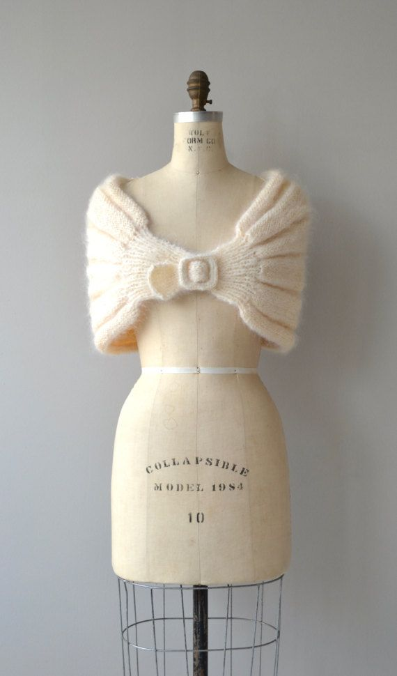 Vintage 1950s cream mohair knit wrap with front clasp closure. --- M E A S U R E M E N T S --- fits like: one size fits all brand/maker: n/a condition: excellent To ensure a good fit, please read the sizing guide: http://www.etsy.com/shop/DearGolden/policy ➸ More tops & sweaters ✩ http://www.etsy.com/shop/DearGolden?section_id=5800171 ➸ Visit the shop ✩ http://www.DearGolden.etsy.com _____________________ ➸ instag...